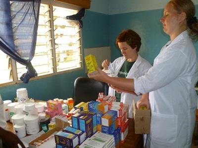 Projects Abroad Medicine interns wearing lab coats at a placement in Africa.
