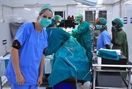 A medical intern shadows a team of surgeons during an operation in India