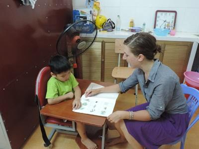 A professional Occupational Therapy volunteer at a placement in Vietnam.