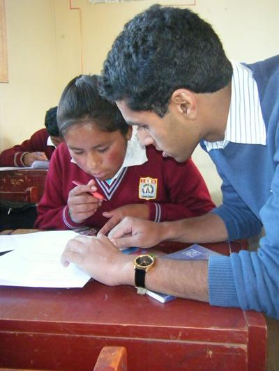 Professional math teacher volunteering with students in Peru