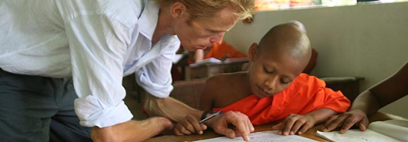 Professional volunteer teaching at a school abroad